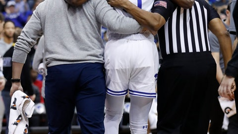 <p>               Seton Hall's Quincy McKnight (0) is assisted off of the court after being injured against Xavier's Tyrique Jones  during the second half of an NCAA college basketball game, Saturday, feb. 1, 2020, in Newark, N.J. Xavier won, 74-62. (AP Photo/Michael Owens)             </p>