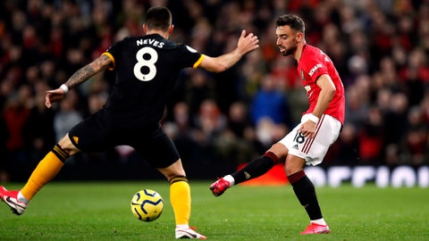 <p>               Manchester United's Bruno Fernandes, controls the ball, during the English Premier League soccer match between Manchester United and Wolverhampton Wanderers, at Old Trafford, in Manchester, England, Saturday, Feb. 1, 2020. (Martin Rickett/PA via AP)             </p>