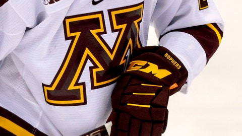 <p>               FILE - In this Oct. 25, 2019 file photo, a Minnesota hockey player skates during an NCAA hockey game in Minneapolis. The University of Minnesota says it is investigating allegations that a former men's hockey assistant coach sexually abused players more than 30 years ago.  (AP Photo/Andy Clayton-King, File)             </p>