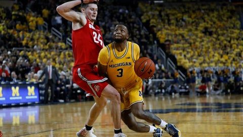 <p>               Michigan guard Zavier Simpson (3) drives on Ohio State forward Kyle Young (25) in the second half of an NCAA college basketball game in Ann Arbor, Mich., Tuesday, Feb. 4, 2020. (AP Photo/Paul Sancya)             </p>