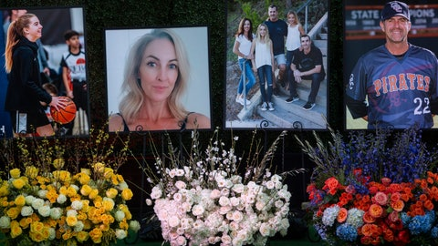 <p>               Flowers and photos honor members of the Altobelli family outside Angel Stadium, Monday, Feb. 10, 2020, in Anaheim, Calif. Coach John Altobelli, 56, far right, his wife, Keri, 43, second from left, and his daughter Alyssa, 13, left, died in a helicopter crash on Jan. 26 in Calabasas. (AP Photo/Damian Dovarganes)             </p>