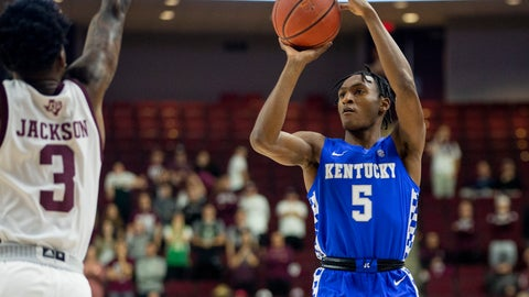 <p>               Kentucky guard Immanuel Quickley (5) shoots a 3-point basket as Texas A&M guard Quenton Jackson (3) defends during the first half of an NCAA college basketball game Tuesday, Feb. 25, 2020, in College Station, Texas. (AP Photo/Sam Craft)             </p>