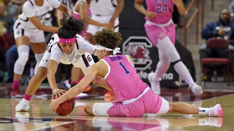 <p>               South Carolina's Destanni Henderson, left, and LSU's Jailin Cherry, front, battle for the ball during the first half of an NCAA college basketball game Thursday, Feb. 20, 2020, in Columbia, S.C. (AP Photo/Richard Shiro)             </p>