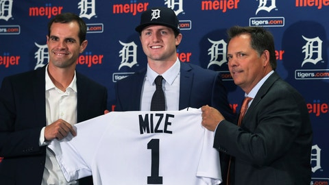 <p>               FILE - In this June 25, 2018, file photo, Detroit Tigers first overall pick Casey Mize, center, stands with Tigers scout Justin Henry, left, and Scott Pleis, director of amateur scouting, during a news conference where he was introduced to the media, in Detroit. Mize was the No. 1 pick in the 2018 draft. He's one of two pitchers headlining Detroit's rebuilding process. The Tigers held their first workout for pitchers and catchers Wednesday, Feb. 12, 2020 and while only the most optimistic Detroit fan would predict a great season in 2020, there are finally some signs of promise. (AP Photo/Carlos Osorio, File)             </p>