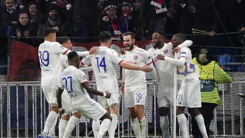 <p>               Lyon players celebrate with Lucas Tousart, center with number 29, who scored his side's first goal during a round of sixteen, first leg, soccer match between Lyon and Juventus at the at the Lyon Olympic Stadium in Decines, outside Lyon, France, Wednesday, Feb. 26, 2020. (AP Photo/Laurent Cipriani)             </p>