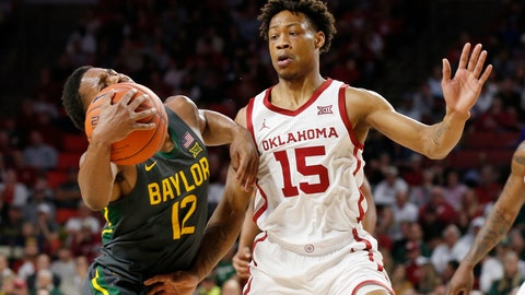 <p>               Baylor guard Jared Butler (12) drives around Oklahoma guard Alondes Williams (15) during the first half of an NCAA college basketball game in Norman, Okla., Tuesday, Feb. 18, 2020. (AP Photo/Sue Ogrocki)             </p>