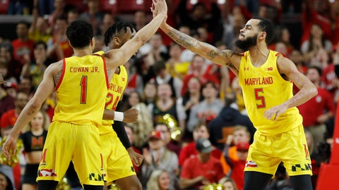 <p>               Maryland guard Eric Ayala (5) is congratulated by guard Anthony Cowan Jr. (1) and forward Donta Scott (24) after scoring a 3-point shot against Nebraska during the second half of an NCAA college basketball game, Tuesday, Feb. 11, 2020, in College Park, Md. Maryland won 72-70. (AP Photo/Julio Cortez)             </p>