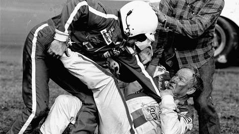 <p>               FILE - In this Feb. 18, 1979, file photo, Bobby Allison, left, grabs Cale Yarborough after a collision between Yarborough and Allison's brother Donnie on the last lap of the Daytona 500 auto race in Daytona Beach, Fla. (AP Photo/Ric Feld, File)             </p>