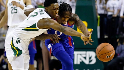 <p>               Baylor guard Devonte Bandoo, left, and Kansas guard Marcus Garrett, right, reach for the loose ball during the first half of an NCAA college basketball game on Saturday, Feb. 22, 2020, in Waco, Texas. (AP Photo/Ray Carlin)             </p>