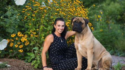 <p>               In this undated photo provided by Cassandra Carpenter, handler Cassandra Carpenter poses with Titus, a bullmastiff. Cassandra says Titus was bitten by a snake on his back left leg in March 2019 in North Carolina. Titus went through extensive treatment and recovery and still has a scar from the episode. He is entered in the Westminster Kennel Club dog show in New York. (Amber Jade via AP)             </p>