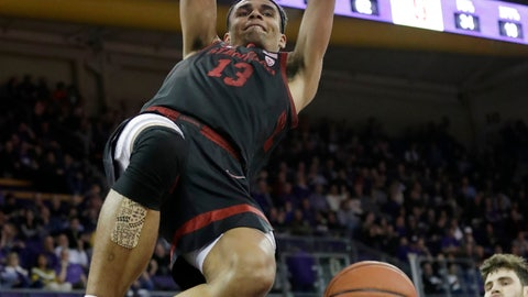 <p>               Stanford's Oscar da Silva hangs from the basket after dunking against Washington late in the second half of an NCAA college basketball game Thursday, Feb. 20, 2020, in Seattle. Stanford won 72-64. (AP Photo/Elaine Thompson)             </p>