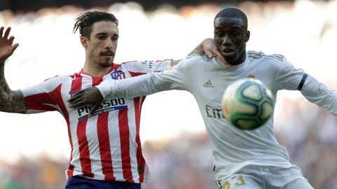 <p>               Atletico Madrid's Sime Vrsaljko, left, challenges for the ball with Real Madrid's Ferland Mendy during a Spanish La Liga soccer match between Real Madrid and Atletico Madrid at the Santiago Bernabeu stadium in Madrid, Saturday, Feb. 1, 2020. (AP Photo/Bernat Armangue)             </p>