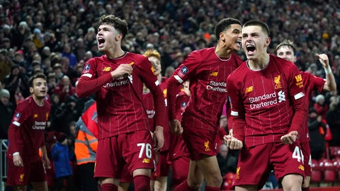 <p>               Liverpool players celebrate after Shrewsbury Town's Ro-Shaun Williams, scored an own goal during the English FA Cup Fourth Round replay soccer match between Liverpool and Shrewsbury Town at Anfield Stadium, Liverpool, England, Tuesday, Feb. 4, 2020. (AP Photo/Jon Super)             </p>