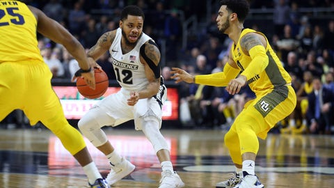 <p>               Providence's Luwane Pipkins (12) is defended by Marquette's Koby McEwen (25) and Markus Howard, right, during the second half of an NCAA college basketball game Saturday, Feb. 22, 2020, in Providence, R.I. (AP Photo/Stew Milne)             </p>