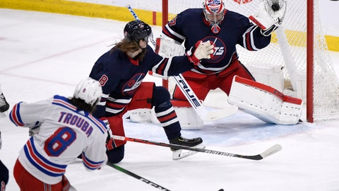 <p>               Winnipeg Jets goaltender Connor Hellebuyck (37) makes a save on a shot from New York Rangers' Jacob Trouba (8) during first period NHL hockey action in Winnipeg, Manitoba on Tuesday Feb. 11, 2020. (Fred Greenslade/The Canadian Press via AP)             </p>