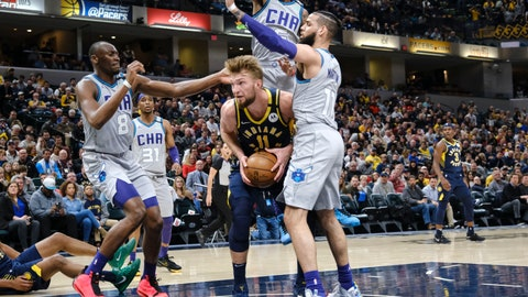 <p>               Indiana Pacers forward Domantas Sabonis (11) is surrounded by Charlotte Hornets defenders Bismack Biyombo (8), Jalen McDaniels (6) and Cody Martin (11) during the second half of an NBA basketball game in Indianapolis, Tuesday, Feb. 25, 2020. The Pacers won 119-80. (AP Photo/AJ Mast)             </p>
