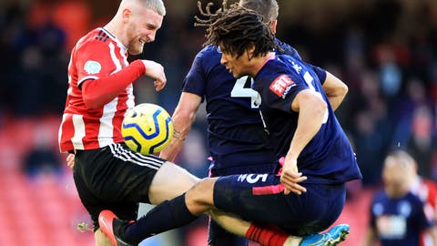 <p>               Sheffield United's Oliver McBurnie, left, and Bournemouth's Nathan Ake battle for the ball during the English Premier League soccer match at Bramall Lane, Sheffield, England, Sunday Feb. 9, 2020. (Danny Lawson/PA via AP)             </p>