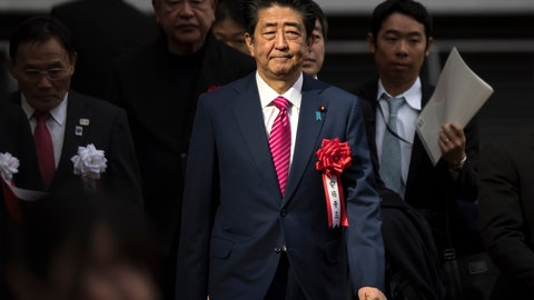 <p>               FILE - In this Dec. 15, 2019, file photo, Japan's Prime Minister Shinzo Abe arrives for the construction completion ceremony of the New National Stadium, the venue for next year's opening and closing ceremony of the Tokyo Olympics and track and field in Tokyo, Japan. In a meeting Monday, Feb. 3, 2020, with the national legislature, Abe reassured them that the Summer Olympics will be taking place on schedule despite rumors of it being affected by the current coronavirus outbreak. (Tomohiro Ohsumi/Pool Photo via AP)             </p>