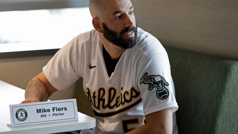 <p>               Oakland Athletics pitcher Mike Fiers waits to speak with the media on Friday, Jan. 24, 2020, in Oakland, Calif. Fiers, the Oakland pitcher and whistleblower in the Houston Astros sign-stealing scandal, appeared with teammates and manager Bob Melvin at team offices. Fiers has not spoken publicly about the sign stealing since the story was published in The Athletic in November. (AP Photo/Ben Margot)             </p>