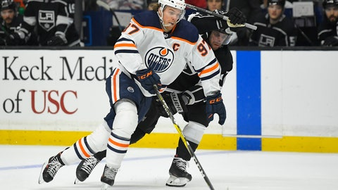 <p>               Edmonton Oilers center Connor McDavid, left, moves the puck while under pressure from Los Angeles Kings center Anze Kopitar during the first period of an NHL hockey game Sunday, Feb. 23, 2020, in Los Angeles. (AP Photo/Mark J. Terrill)             </p>