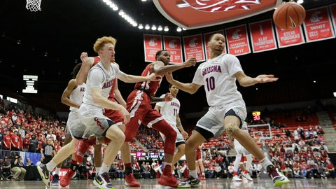 <p>               Arizona guard Nico Mannion, left, and guard Jemarl Baker Jr., right, and Washington State guard Marvin Cannon go after the ball during the second half of an NCAA college basketball game in Pullman, Wash., Saturday, Feb. 1, 2020. Arizona won 66-49. (AP Photo/Young Kwak)             </p>