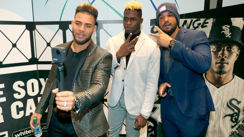 <p>               Chicago White Sox's Yoan Moncada, left, Luis Robert, center, and Jose Abreu pose for a video during the team's annual fan convention Friday, Jan. 24, 2020, in Chicago. (AP Photo/Charles Rex Arbogast)             </p>