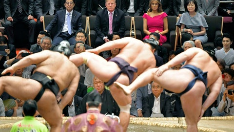 <p>               FILE - In this May 26, 2019, file photo, U.S. President Donald Trump, center back, and first lady Melania Trump, second right back, accompanied by Japanese Prime Minister Shinzo Abe, left, and his wife Akie Abe watch the ring-entering ceremony of sumo wrestlers during an annual summer sumo wrestling championship at the Ryogoku Kokugikan sumo arena in Tokyo. Sumo wrestling is going to get some extra attention because of the Tokyo Olympics. The Japan Sumo Association and local Olympic organizers are planning a sumo tournament on Aug. 12-13, just days after the Olympics end. (Kyodo News via AP)             </p>