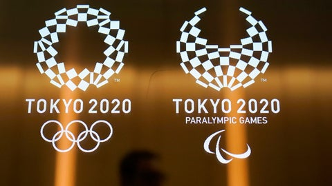 "<p>               FILE - In this June 11, 2019, file photo, a man walks past the logos of the Tokyo 2020 Paralympics and Olympics in Tokyo. Tokyo Olympic and Paralympic organizers are again trying to squelch fears that that this summer's games could be postponed or cancelled. Toshiro Muto is the CEO for the games and he went out of his way to say ""the Olympics and Paralympics will be held as planned."" (AP Photo/Jae C. Hong, File)             </p>"