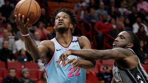 <p>               Miami Heat forward Jimmy Butler (22) goes up for a shot against Brooklyn Nets forward Taurean Prince (2) during the first half of an NBA basketball game, Saturday, Feb. 29, 2020, in Miami. (AP Photo/Wilfredo Lee)             </p>