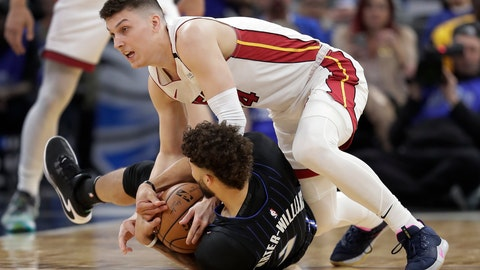 <p>               Miami Heat guard Tyler Herro, top right, goes after the ball against Orlando Magic guard Michael Carter-Williams, bottom, during the first half of an NBA basketball game, Saturday, Feb. 1, 2020, in Orlando, Fla. (AP Photo/John Raoux)             </p>
