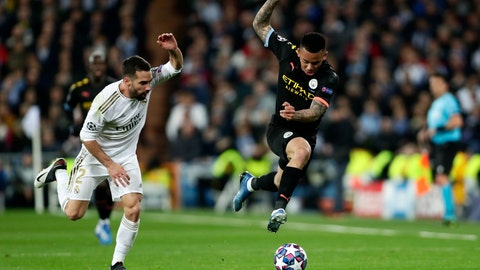 <p>               Manchester City's Gabriel Jesus, right, and Real Madrid's Dani Carvajal run for the ball during the Champions League, round of 16, first leg soccer match between Real Madrid and Manchester City at the Santiago Bernabeu stadium in Madrid, Spain, Wednesday, Feb. 26, 2020. (AP Photo/Manu Fernandez)             </p>