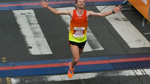 "<p>               FILE - In this March 15, 2015, file photo, Jared Ward, from Provo, Utah, crosses the finish line at the Los Angeles Marathon in Santa Monica, Calif. Ward, who finished third in the 2016 trials in Los Angeles and placed sixth in the 2016 Rio Olympics, said concern about the Olympics and the new virus from China is real. ""I think from my perspective what I have to do is just ignore it and go out and race."" (AP Photo/Damian Dovarganes, File)             </p>"