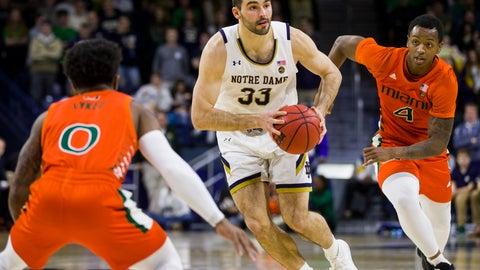 <p>               Notre Dame's John Mooney (33) looks to pass between Miami's Chris Lykes (0) and Keith Stone (4) during the second half of an NCAA college basketball game Sunday, Feb. 23, 2020, in South Bend, Ind. (AP Photo/Robert Franklin)             </p>