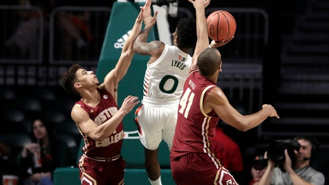 <p>               Miami guard Chris Lykes (0) is fouled by Boston College guard Derryck Thornton, left, as forward Steffon Mitchell (41) defends during the first half of an NCAA college basketball game, Wednesday, Feb. 12, 2020, in Coral Gables, Fla. (AP Photo/Lynne Sladky)             </p>