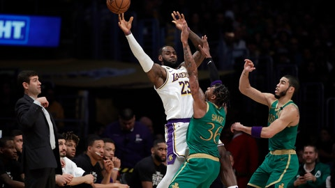 <p>               Los Angeles Lakers' LeBron James (23) is defended by Boston Celtics' Marcus Smart (36) and Jayson Tatum during the first half of an NBA basketball game Sunday, Feb. 23, 2020, in Los Angeles. (AP Photo/Marcio Jose Sanchez)             </p>