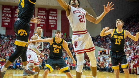 <p>               Iowa guard Bakari Evelyn (4), left, swats the ball away from Indiana forward Jerome Hunter (21) who drives to the basket during the first half of an NCAA college basketball game, Thursday, Feb. 13, 2020, in Bloomington, Ind. (AP Photo/Doug McSchooler)             </p>