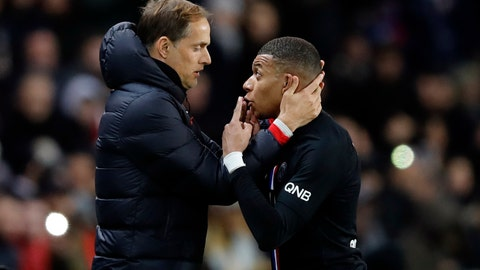 <p>               PSG's Kylian Mbappe, right, talks with PSG's head coach Thomas Tuchel during the French League One soccer match between Paris-Saint-Germain and Montpellier at the Parc des Princes stadium in Paris, Saturday Feb. 1, 2020. (AP Photo/Christophe Ena)             </p>