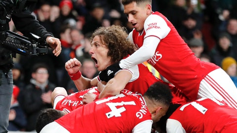 <p>               Arsenal's David Luiz shouts as he celebrates with team mates his side's fourth goal, scored by Alexandre Lacazette during the English Premier League soccer match between Arsenal and Newcastle at the Emirates Stadium in London, Sunday, Feb. 16, 2020.(AP Photo/Frank Augstein)             </p>