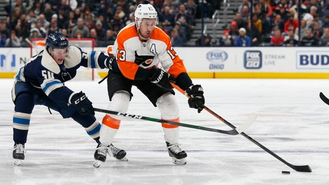 <p>               Philadelphia Flyers' Kevin Hayes, right, carries the puck across the blue line as Columbus Blue Jackets' Eric Robinson defends during the third period of an NHL hockey game Thursday, Feb. 20, 2020, in Columbus, Ohio. (AP Photo/Jay LaPrete)             </p>
