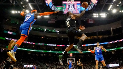 <p>               Milwaukee Bucks' Eric Bledsoe shoots past Oklahoma City Thunder's Dennis Schroder during the second half of an NBA basketball game Friday, Feb. 28, 2020, in Milwaukee. (AP Photo/Morry Gash)             </p>