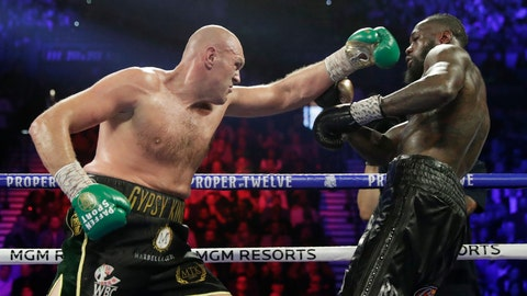 <p>               Tyson Fury, left, of England, fights Deontay Wilder during a WBC heavyweight championship boxing match Saturday, Feb. 22, 2020, in Las Vegas. (AP Photo/Isaac Brekken)             </p>