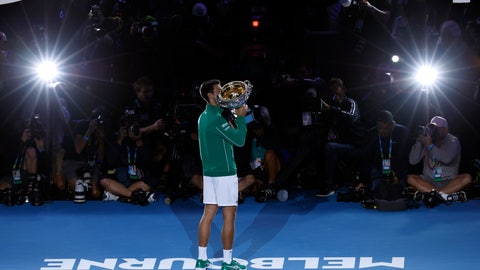 <p>               Serbia's Novak Djokovic kisses the Norman Brookes Challenge Cup after defeating Austria's Dominic Thiem in the final of the Australian Open tennis championship in Melbourne, Australia, early Monday, Feb. 3, 2020. (AP Photo/Dita Alangkara)             </p>