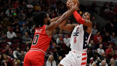 <p>               Washington Wizards' Troy Brown Jr. (6) goes up to shoot against Chicago Bulls' Coby White (0) during the first half of an NBA basketball game Sunday, Feb. 23, 2020, in Chicago. (AP Photo/Paul Beaty)             </p>