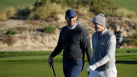 <p>               Tony Romo, left, talks with Jim Furyk while walking up to the second green of the Spyglass Hill Golf Course during the first round of the AT&T Pebble Beach National Pro-Am golf tournament Thursday, Feb. 6, 2020, in Pebble Beach, Calif. (AP Photo/Eric Risberg)             </p>