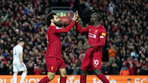 <p>               Liverpool's Mohamed Salah, front left, celebrates with Liverpool's Sadio Mane after scoring his side's opening goal during the English Premier League soccer match between Liverpool and Sheffield United at Anfield Stadium, Liverpool, England, Thursday, Jan. 2, 2020. (AP Photo/Jon Super)             </p>