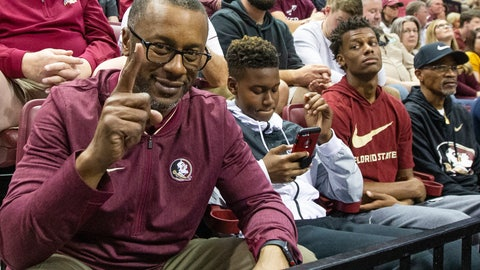 <p>               FILE - In this Jan. 12, 2019, file photo, then-Florida State head football coach Willie Taggart watches an NCAA college basketball game with his son's Jackson and Willie, Jr. in Tallahassee, Fla. Florida Atlantic announced that quarterback Willie Taggart Jr. signed with the Owls on Wednesday, Feb. 5, 2020, meaning he will play for his father, the new FAU coach. (AP Photo/Mark Wallheiser, File)             </p>