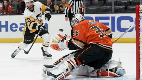 <p>               Anaheim Ducks goaltender John Gibson blocks a shot by Pittsburgh Penguins defenseman Kris Letang during the first period of an NHL hockey game in Anaheim, Calif., Friday, Feb. 28, 2020. (AP Photo/Chris Carlson)             </p>