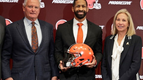 <p>               Cleveland Browns general manager Andrew Berry, center, poses for a photo with owners Jimmy Haslam, left, and Dee Haslam, right, after speaking during a news conference at the NFL football team's training facility, Wednesday, Feb. 5, 2020, in Berea, Ohio. Berry returned to the team after a one-year stint in the Philadelphia Eagles' front office. Berry was the Browns' vice president of player personnel from 2016-18. (AP Photo/Tony Dejak)             </p>