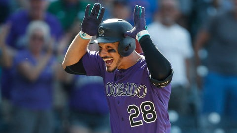 <p>               FILE In this Aug. 14, 2019, file photo, Colorado Rockies' Nolan Arenado celebrates as he circles the bases after hitting a walkoff, two-run home run off Arizona Diamondbacks relief pitcher Archie Bradley in the ninth inning of a baseball game in Denver. Arenado is at odds with the team's front office as the Rockies head to spring training for the season ahead. (AP Photo/David Zalubowski, File)             </p>