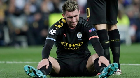 <p>               Manchester City's Aymeric Laporte sits injured on the pitch during the round of 16 first leg Champions League soccer match between Real Madrid and Manchester City at the Santiago Bernabeu stadium in Madrid, Spain, Wednesday, Feb. 26, 2020. (AP Photo/Bernat Armangue)             </p>